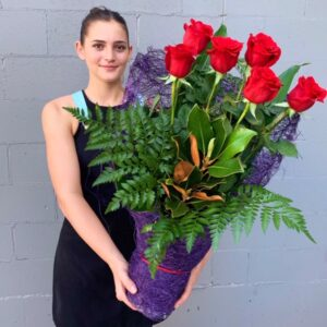 Half dozen red roses hand delivered by florist Miami Queensland