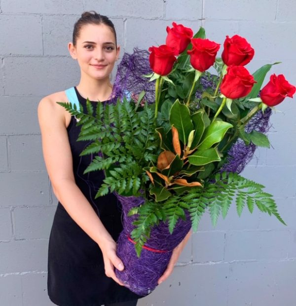 Half dozen red roses hand delivered by florist Miami Queensland